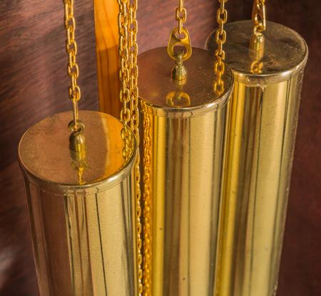 pendulum: gold color of pendulum clock, luxury vintage clock Stock Photo