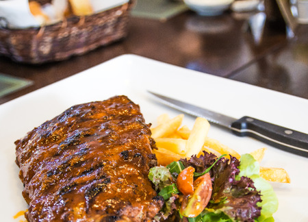 closeup pork rib fired on white square dish