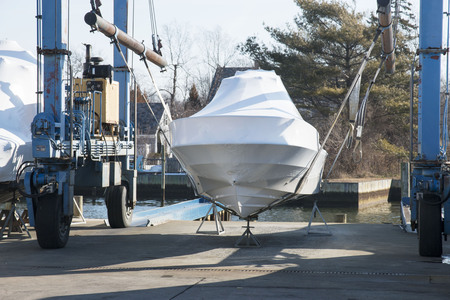 A boat is stored on a sling ready to be put into the water