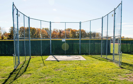 Fenced in discus cage for high school athletics Stock Photo