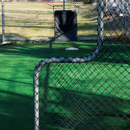 pitching: Looking toward home plate from behind the pitching screen in a batting cage