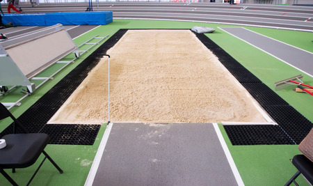 a long jumptriple jump pit is full of sand and ready for competition