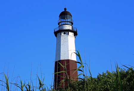 montauk: The Montauk Lighthouse taken from behind on the boulders Stock Photo