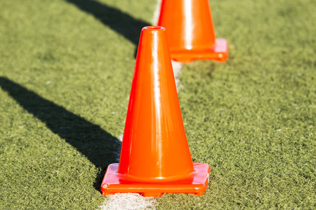 Orange cones on a green turf field up close Stock fotó