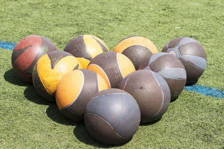 Medicine balls in the form of a triangle on a green turf filed Stock fotó