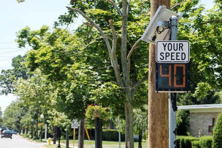A radar is set up to let drivers know their speed in a local village.
