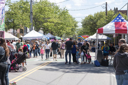 Babylon, New York, USA - 3 June 2017: People enjoying the annual Babylon Village street fair on Deer Park Ave, with lots of vendors, rides and food. Editorial