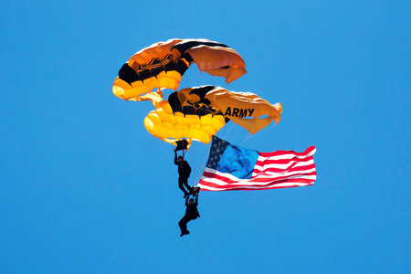 US Army paratroopers falling from the sky while carying the american flag at practice for an air show, Friday May 26, 2017 at Jones Beach, NY Long Island Redakční