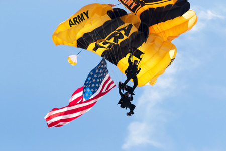 Wantagh, NY, United States - 26 May 2017: US Army paratroopers carying the american flag open up the practice show for the air show that was to be held the next two days during memorial day weekend at Jones Beach, NY.