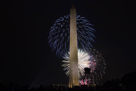 A great fireworks show held on the fourth of July in Washington DC with the Washington monument in the forground