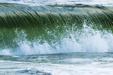 power giant: A large wave, formed by a storm offshore, crashes on the shoreline of Fire Island New York. Stock Photo