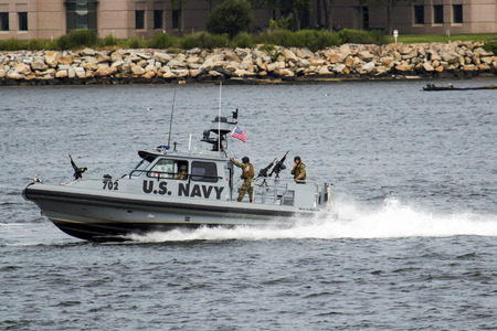 New London, Connecticut, USA - 2772017: A U.S. Navy armed patrol boat protects the waters of the Long Island Sound in the  harbor around New London Connecticut.