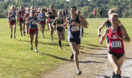 Wappingers falls, New York, USA - 23 September 2017: The lead pack of the varsity high school girls cross country race at the Bowdoin Park Cross Country Invitational around 400 meters into the 5K race.