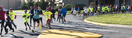 Wet Islip, NY, USA - 24 November 2017: The annual Run Your Turkey Off 4K road race with runners starting in a parking lot and entering the road to run through the neighborhood. Sajtókép