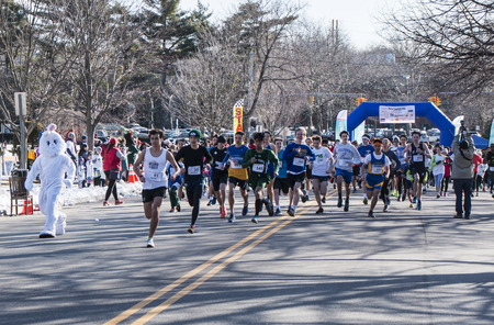 Garden City, NY, USA – 24 March 2018: Race start with Easter Bunny racing at the Run for Tomorrows Hope Foundation 5K, to support Catholic Education on Long Island. Sajtókép
