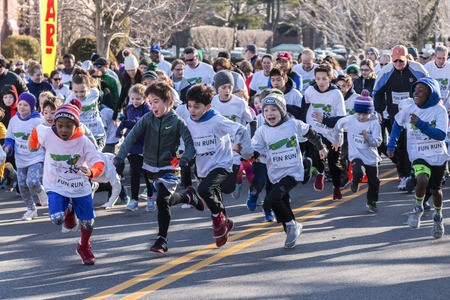 Garden City, NY, USA – 24 March 2018: Kids Fun Run start at the Run for Tomorrows Hope Foundation 5K, to support Catholic Education on Long Island.