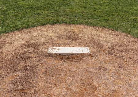 A baseball fields pitchers mound close up.