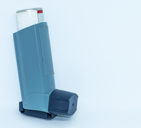 One inhaler standing in front of white backgound with room for advertising space.