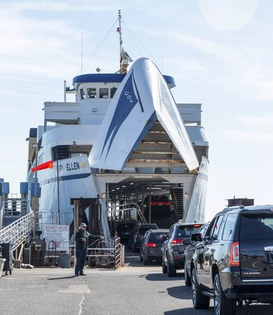 Orient Point, New York, USA - 19 October 2018: The ferry boat The Mary Ellen is loading cars underneath to ship across to New Lomdon Conneticuit.