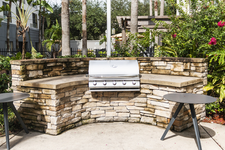 A hotel in Florida has a gas barbecue available for customers to grill food and gather in its garden.