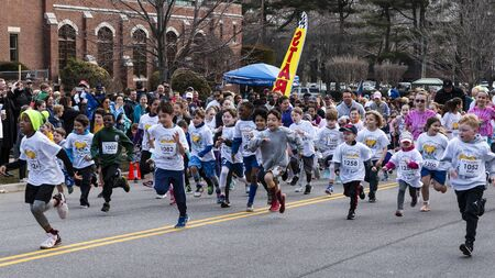 Garden City, NY, USA – 30 March 2019: Kids Fun Run start at the Run for Tomorrows Hope Foundation 5K, to support Catholic Education on Long Island.