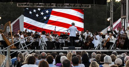 East Islip, NY, USA - 13 July 2019: The Long Island Concert Orchestra performing for free at night under the stars at Heckscher State Park.