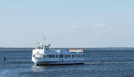 A ferry boat transporting people from Fire Island to Bay shore travelling in the Great South Bay. Imagens