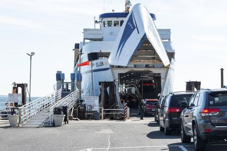 Orient Point, New York, USA - 19 October 2018: A ferry boat is loading up cars in Orient Point to take them across the water to New London Conneticuit.