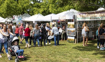 Babylon, New York, USA - 8 September 2019: People enjoying a sunny day shipping for local goods around Argyle Lake during the annual Babylon Beautification Society Fair.