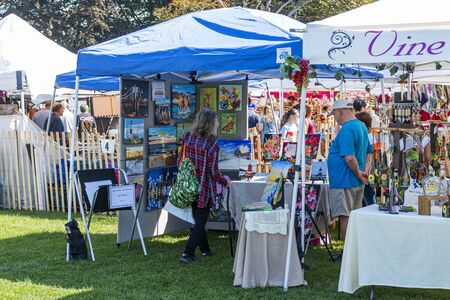 West Islip, New York, USA - 22 September 2019: People shopping and asking questions to the vendors at the annual West Islip goods fair. Editöryel
