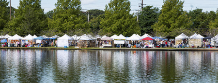 Babylon, New York, USA - 8 September 2019: View of craft tents on the edge of Argyle Lake during the annual Babylon Beautification Society Fair.