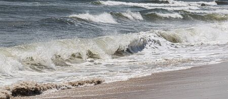 Atlantic ocean waves rolling on to the shore off the coast of Fire Island, Long Island, New York.