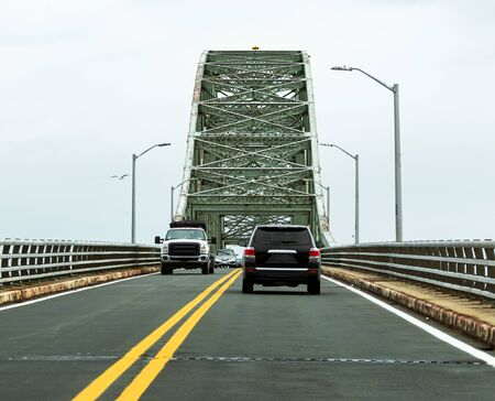 Cars traveling on the Robert Moses bridge going to and from the Fire Island National Sea shore beaches.