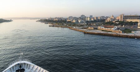 25 July 2018: View of Havana Cuba from a cruise ship that is entering Havana harbor with the tip of the ship in view.