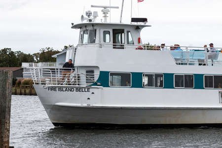 Bay shore, New York, USA - 6 October 2019: The Fire Island Belle ferry boat returning to the docks in Bay Shore to deliver people back to the main land from the Fire Island Nationals Seas Shore.