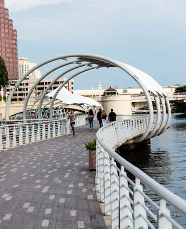 Tampa, Florida, USA - People walking and running on the River Walk along the water in Tampa Florida. Publikacyjne