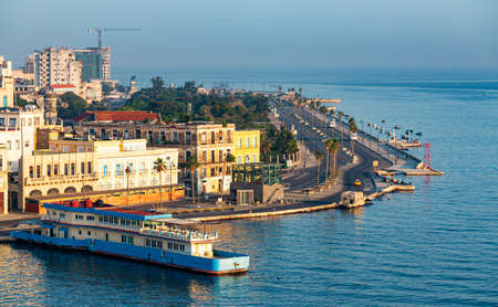 Havana, Cuba - 25 July 2018: View from on top of a cruise ship of Old Havana and El Malecon road on a hazy summer morning.