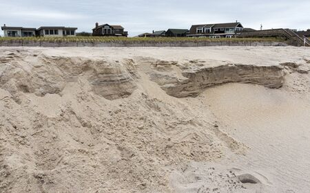 A beach on Fire Island with heavy erosion after the sand is washed away from a storm. Фото со стока