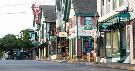 Bar Harbor, Maine, USA - 29 July 2017: Five in the morning view of the main shopping street soon to be fillied with tourists walking and shopping.
