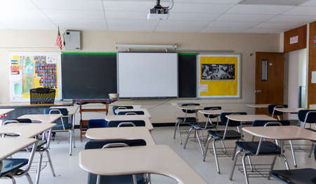 West Islip, New York, USA - 3 June 2020: High school classroom in New York is still empty after months of no classes due to the Covid-19 Coronavirus pandemic. Редакционное