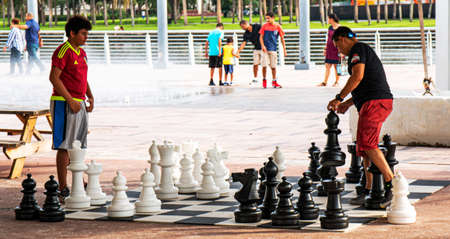 Atlanta, Georgia , USA - 21 July 2018: People in a park in Atlanta walking through water fountains and playing chess with giant game pieces.