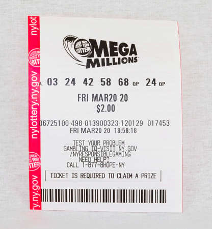 Babylon, New York, USA - 11 April 2020: A losing Mega Millions ticket for the March 20 drawing wih a whith background.