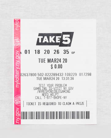 Babylon, New York, 11 April 2020: Losing take 5 lottery ticket from March 24 2020 with a white background.