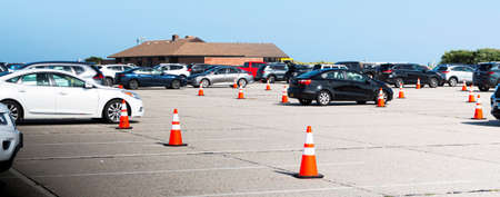 Babylon, New York, USA - 3 August 2020: State Park beaches parking lot with orange construction cones in every other spot to reduce capacity for social distancing proticol during Coronavirus.