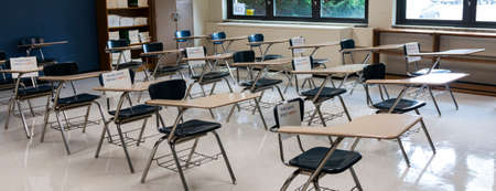 A socially distant High School classroom is ready for students to return with signs marking desks not to be used to keep the kids further apart.