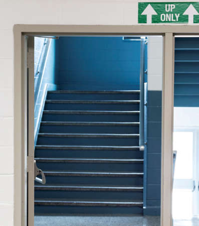 To help get back to in person teaching a high school has arrainged up and down only staircases and one way halls to help the students stay six feet apart and socially distant.