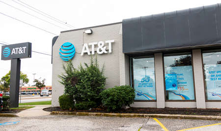 Deer Park, New York UsA - 29 August 2020: A stand alone AT&T store on a busy road in New York. Editorial