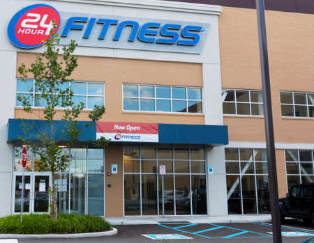 East Northport, New York, USA - 1 September 2020: The entrance of a 24 hour fitness club with a now open sign. Editorial