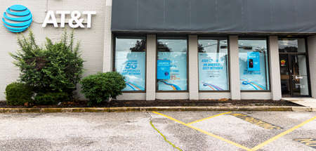 Deer Park, New York, USA - 29 August 2020: Horizontal picture of the outside of a stand alone AT&T store taken from the parking lot.
