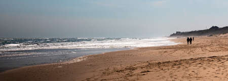 Horizontal picture of Montauk Beach looking west down the beach and ocean on a chilly April day during the pandemic in 2020.